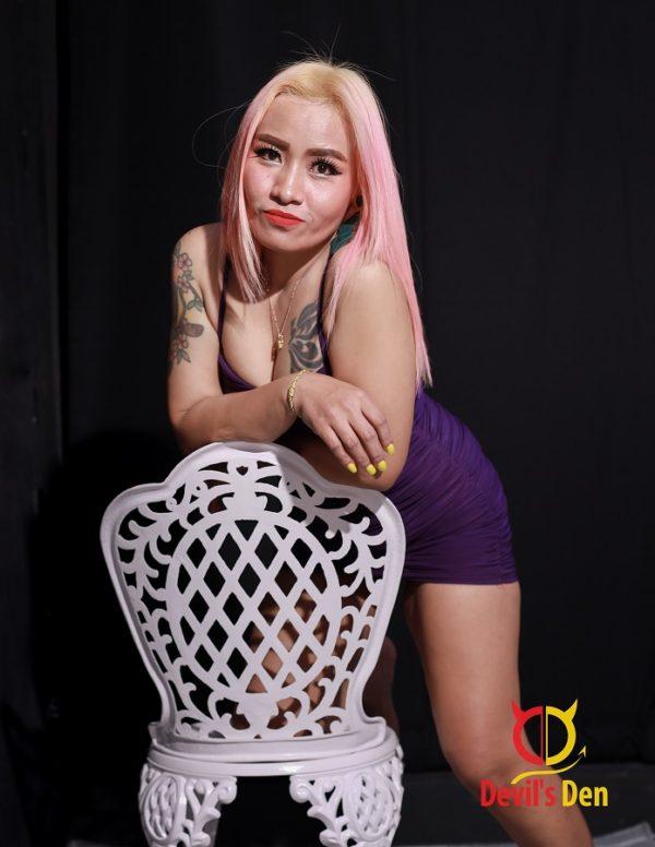 Thai escort with pink hair